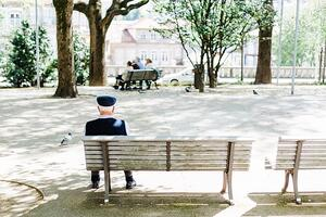 Man on bench in city