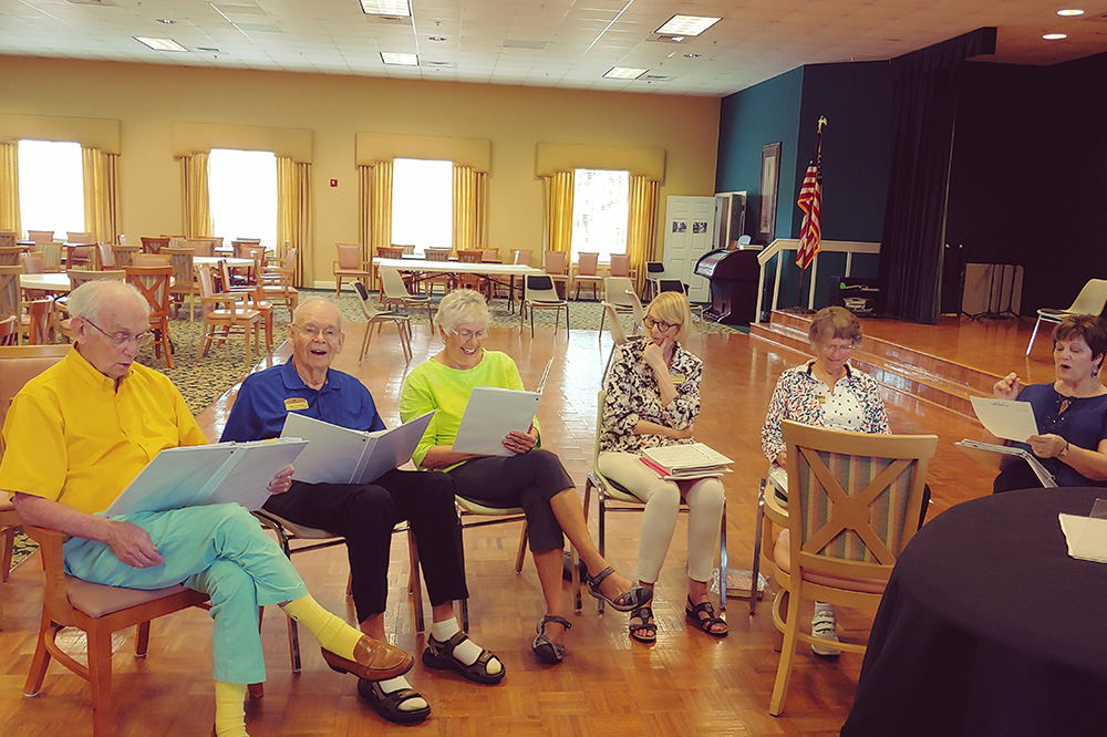 seniors socializing at book club at SBc