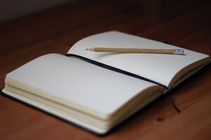journal and pencil on desk