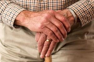 senior holding hand
