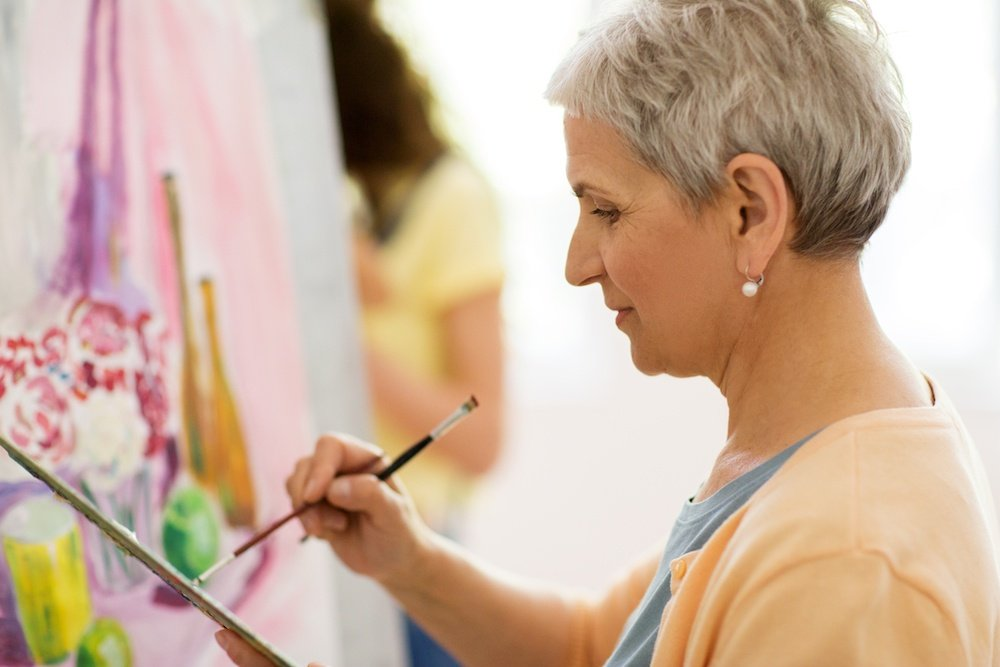 woman painting senior