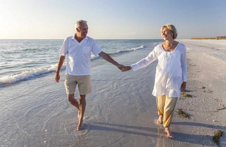 active seniors in retirement on the beach