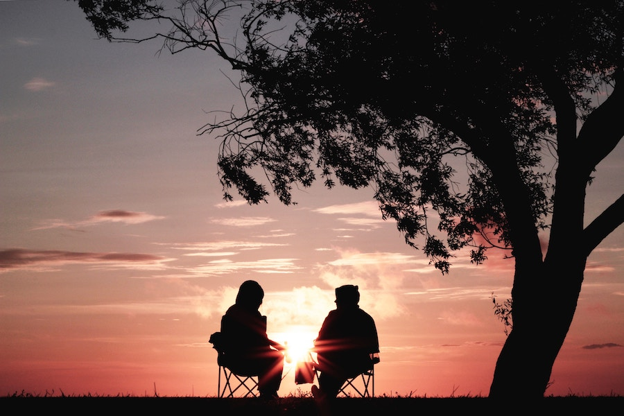 two people in front of the sunset retirement